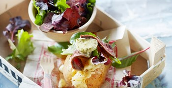 Jacket Potato with salad mix, beefsteak and herb butter